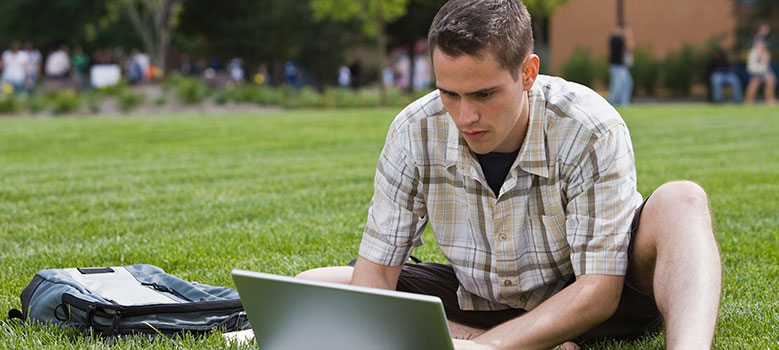 Student studying outside with laptop